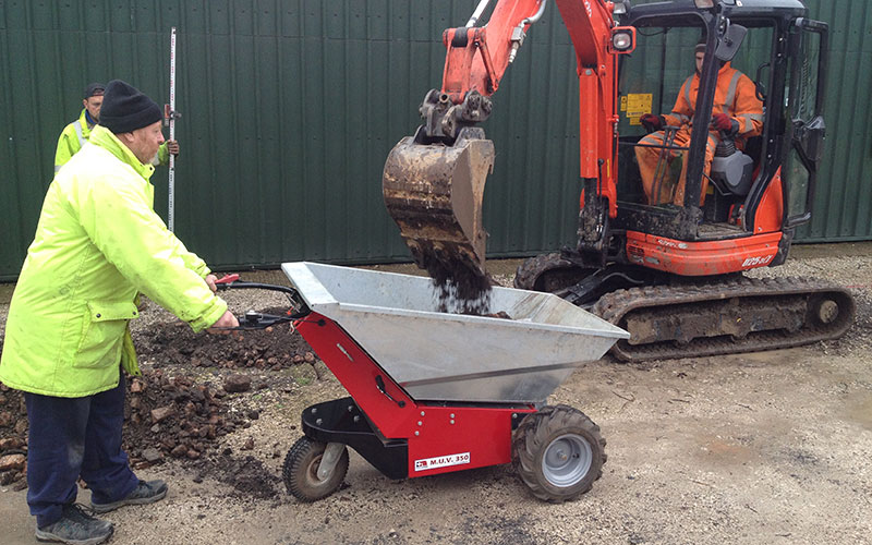 MUV - Electric powered Wheelbarrow being loaded by mini-digger