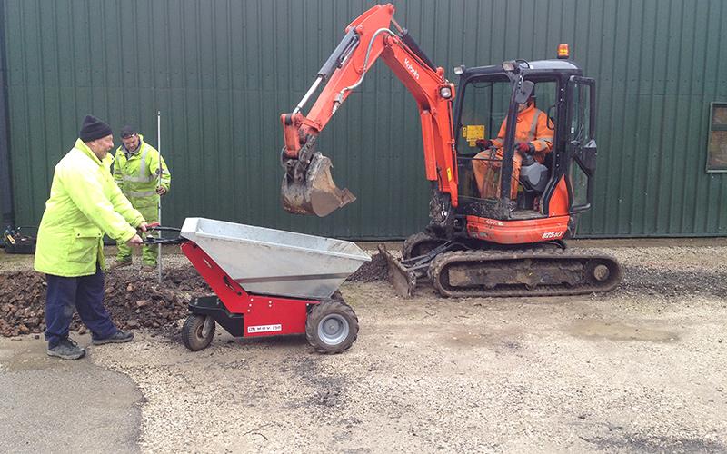 Mini digger loading MUV - Electric Wheelbarrow