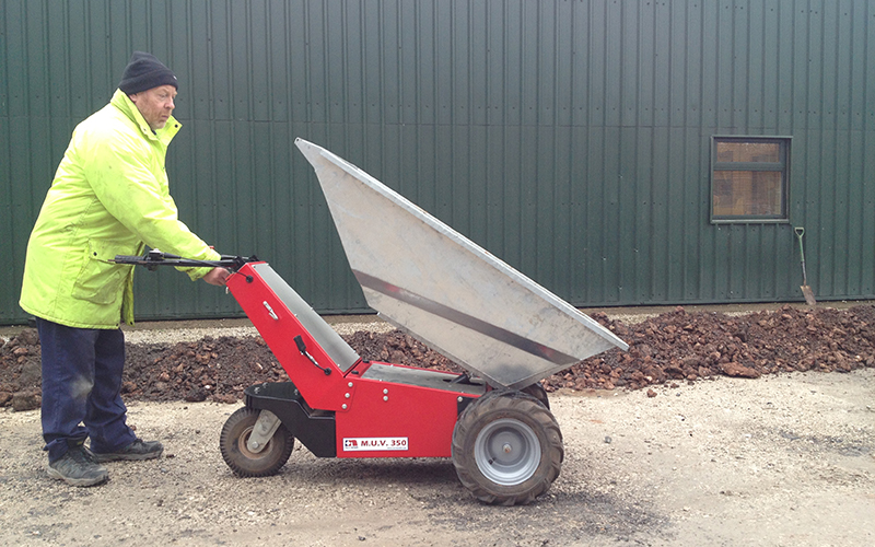 MUV Electric Wheelbarrow with galvanized steel tub to show electric tip operation