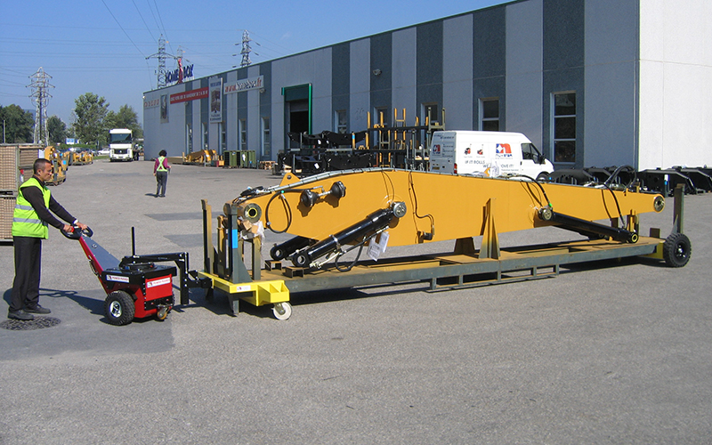 Power Pusher with Steering Arm moving a 3,500Kg excavator boom on mobile stillage