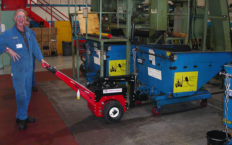 Power Pusher, with Steering Arm, moving Emteezy tipping skip in machine shop