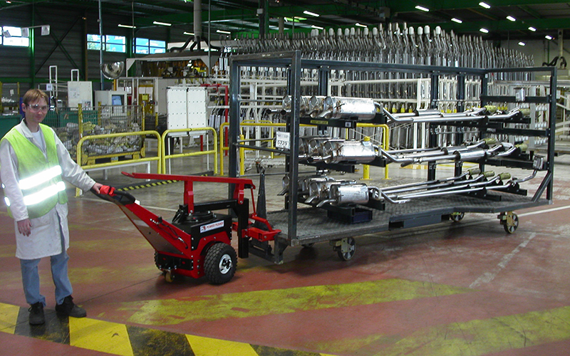 Power Pusher, with Steering Arm, moving trolley loaded with exhaust assemblies at Faurecia, France