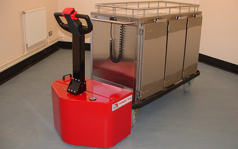 PowerTug moving Corsair heated food trolley in prison kitchens