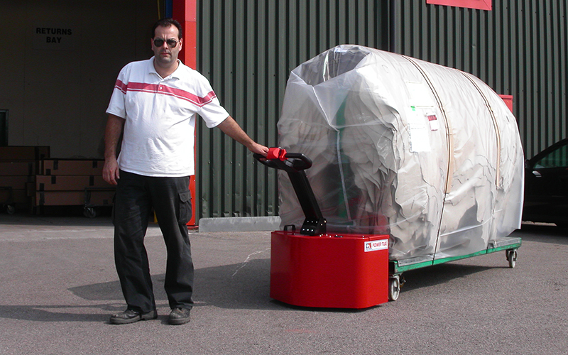 Powertug moving 2,000Kg leather hides on 'A' frame trolley