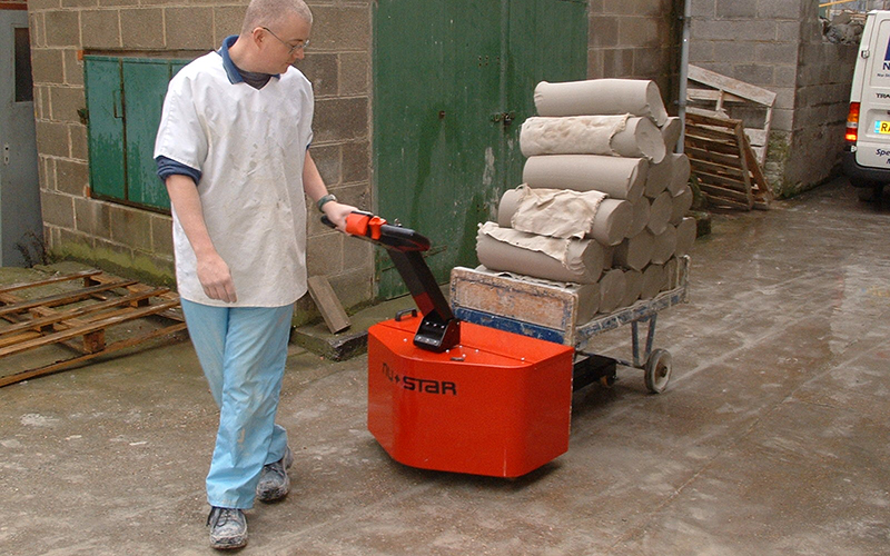 PowerTug moving trolley loaded with clay in Pottery works