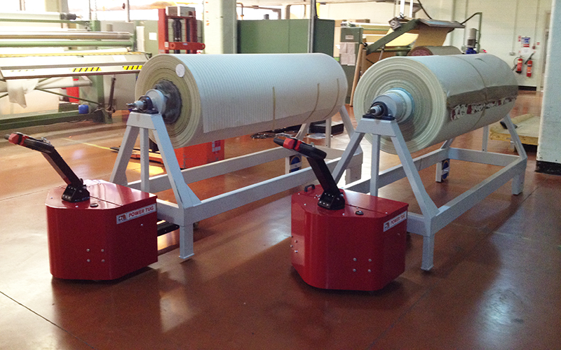 Power Tugs moving 3,500Kg fabric roll trolleys