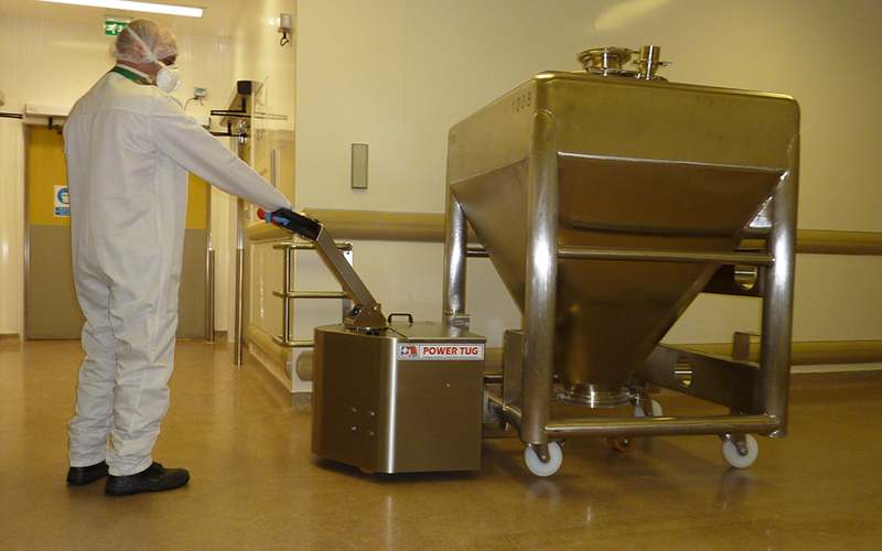 Stainless Steel PowerTug moving 1,000Kg Pharmaceutical mixing vessel with alll 4 swivel castors