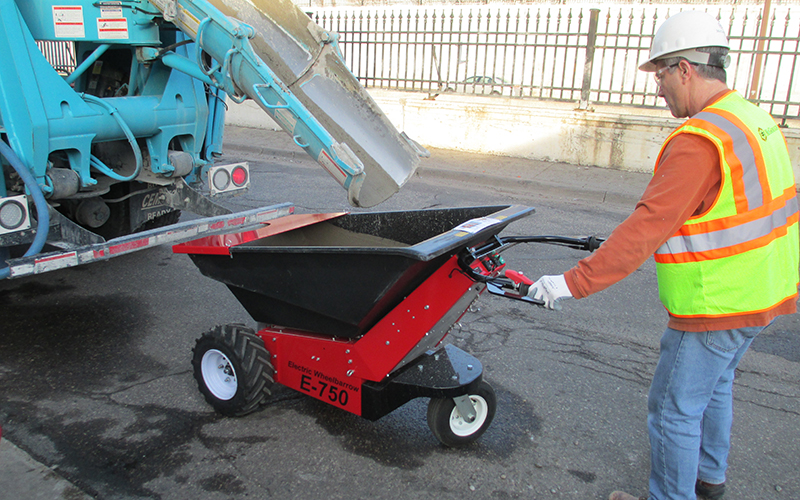 Using the MUV electric wheelbarrow to transport concrete from roadside delivery lorry
